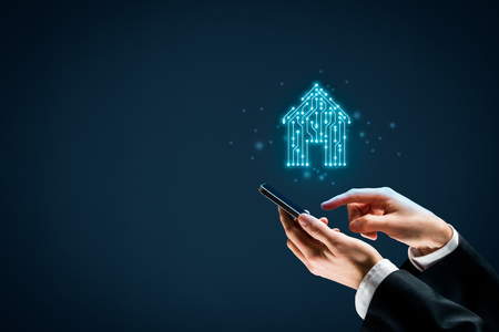 Smart home, intelligent house, and home automation app concept. Smart house icon with pcb design and person with smart phone. Stock Photo