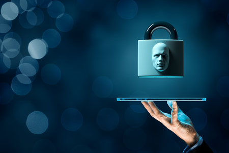 Digital tablet face detection and identification (ID) concept. Padlock with face is metaphor of unlocking tablet via face identification. Stock Photo