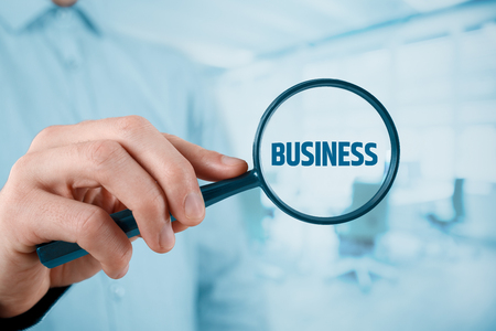 Business analysis concept. Businessman is focused on his business, office in background Stock Photo