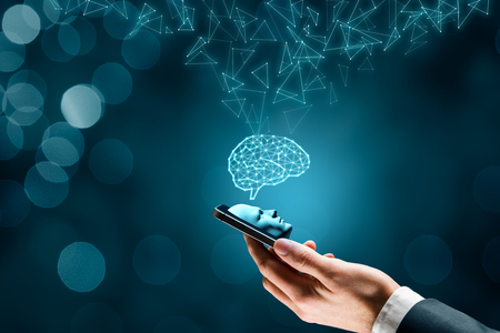 Artificial intelligence on smartphone concept. Smart phone user and brain representing artificial intelligence. Stock Photo