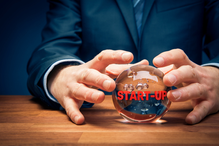 Start-up business prediction concept with crystal ball. Look into the crystal ball. Investor visionary with crystal ball and text start-up.