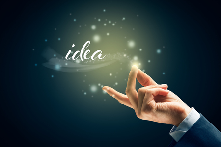 Magic of the birth of the idea concept - to have new idea is easy as snap fingers. Creativity and vision concept.