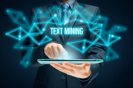 Text mining - process of deriving high-quality information from text. Text analysis concept with digital tablet. Zdjęcie Seryjne