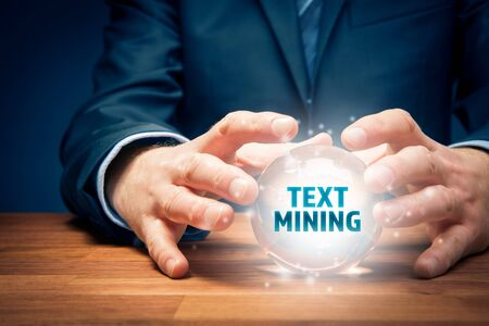 Businessman look into the crystal ball to text mining analysis. Zdjęcie Seryjne