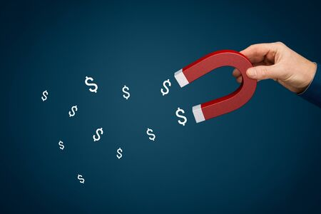 Financial success concept - magnet for money dollars concept. Hand of businessman with magnet attract symbols of dollar.