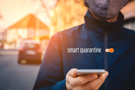 Turn on smart quarantine monitoring system and self-isolation concept. Person with smart phone turn on notifications about risk of come into contact with the infected person.