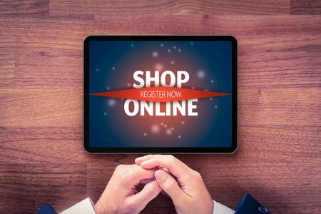 Shop online and register to new e-shop concepts. Businessman with digital tablet and call to action. Banque d'images - 144135172