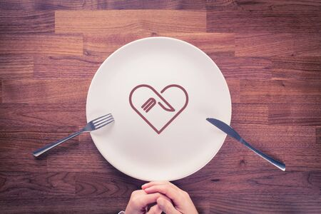 Love eating gourmet and gastronome concept. Finish eating gourmet with empty plate. Stock Photo