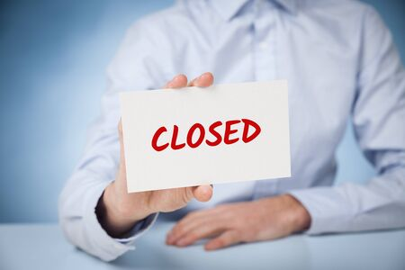 Business closed bankruptcy concept. Businessman with card and text business closed. Stock Photo