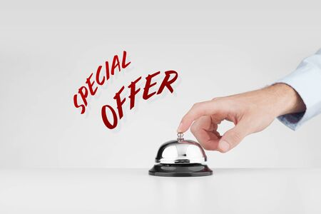 Special offer marketing concept. Marketer beats alarm (press ring bell) to point out special marketing offer. Stock Photo