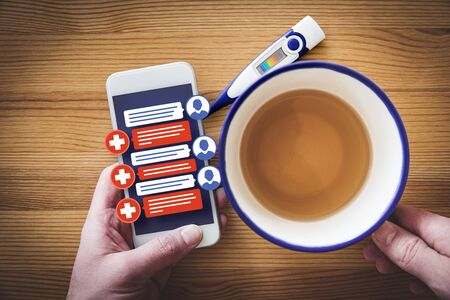 Chat on smartphone with doctor practitioner. Patient with flu symptoms communicate online with medical practitioner - new trend in medicine and smart health-care.
