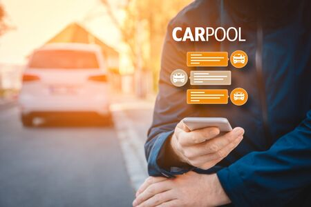 Carpool concept - modern form of mobility passenger transport. Person with smartphone is looking for carpooling or rideshare. Stock Photo