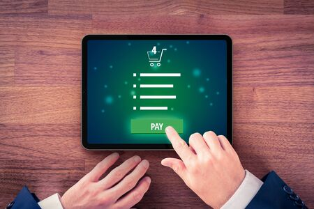 Payment in e-shop on digital tablet, e-commerce online buying concept. Stock Photo