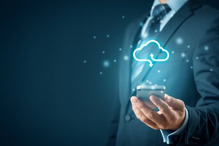 Cloud computing concept - connect smart phone to cloud. Businessman or information technologist with cloud computing icon and smart phone.