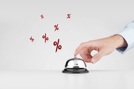 Sale marketing concept. Marketing specialist beats alarm (press ring bell) to advertise sale campaign. Stock Photo