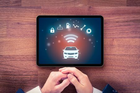 Intelligent car app on digital tablet concept, intelligent vehicle and smart cars concept. Symbol of the car and information via wireless communication about car.