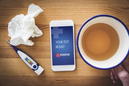 Positive medical test notification on patient smart phone. Use of modern technologies in pandemic times like covid-19, coronavirus, flu, and similar. Stock Photo