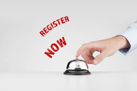 Register now concept. Marketing specialist beats alarm (press ring bell) to advertise registration in new online service. Stock Photo