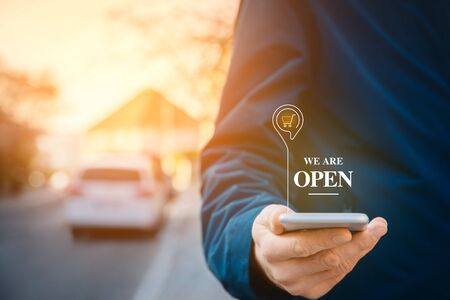 We are open - shop notification on smart phone concept. Store and shop opening after closing due to covid-19 and quarantine. Stock Photo