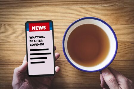 Post covid-19 news and analysis of covid-19 anti-epidemic measures impact to business concept. Business news about new phase and opportunity for businessman and investors after end of covid-19 pandemic. Smart phone user read news during breakfast.