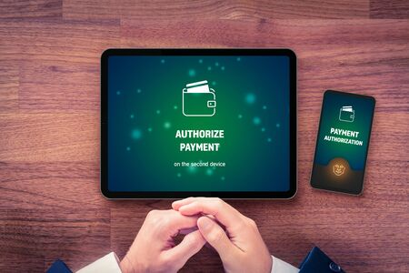 Online payment authorization on smart phone concept. Internet banking user and secure payment in e-shop and e-commerce. Biometrics authorization with face identification. Stock Photo