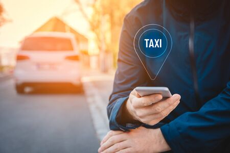 Taxi searching on smart phone concept. Smart phone user is looking for taxi service outside. Stock Photo