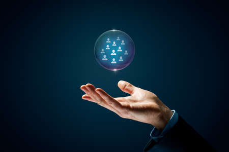 Catch dream team human resources concept. Hand with soap bubble (symbol of dream) with group of business person inside. Crisis after covis-19 pandemic is opportunity to have new employees.