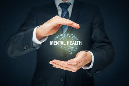 Protect your mental health psychology concept. Psychologist with protective hand gesture and symbol of brain and text mental health. Archivio Fotografico