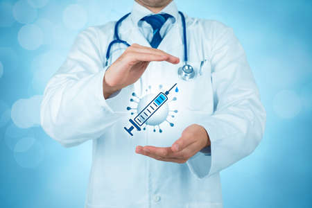 Doctor practitioner with protective gesture and symbol of vaccine and virus. Covid-19 health-care and pharmaceutic concept. Stock Photo