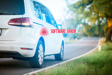 Car software error concept. Immobile intelligent car due to software error stands at side of the road. Software failure and its impact to autonomous vehicle concept. Zdjęcie Seryjne