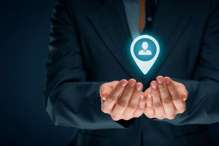 Target customer, customer care and human resources (HR) concept. Businessman hold target customer, employee (or another business person) in hand. Central composition.