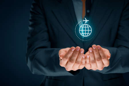 Travel insurance and business travel concepts. Insurance agent or businessman with protective gesture and icon of plane and globe. Zdjęcie Seryjne