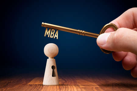 Key to your MBA education concept. Hand holding key with text MBA. Education is key to success.