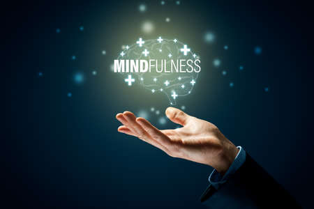 Mindfulness is key for mental and physical health. Hand with symbol of brain and text mindfulness.