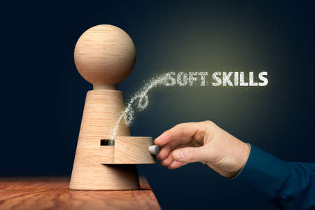Discover your soft skills concept. Coach (manager, mentor) open drawer from wooden figurine, there is hidden skills going out.