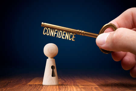 Key to your confidence is in your hand. Personal development and self-confidence concept. Imagens