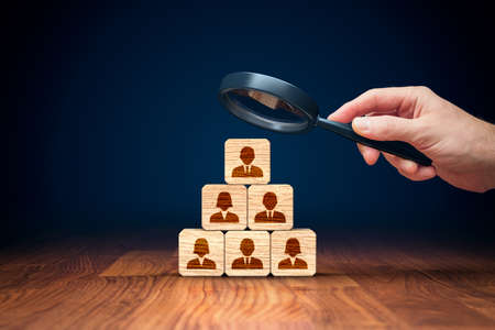Human resources, corporate hierarchy concept and multilevel marketing. Recruiter focused on human resources.