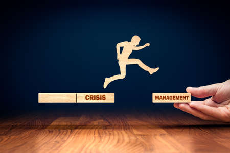The crisis manager helps company overcome crisis after covid-19 to start new phase of business. Crisis is an opportunity concept. Post covid-19 era management helping hand concept.