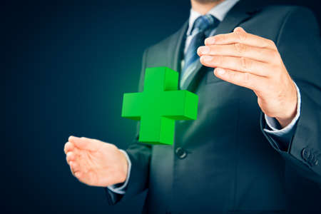 Positive thinking and health care concept. Business person with protective gesture and green pharmacy symbol of plus.