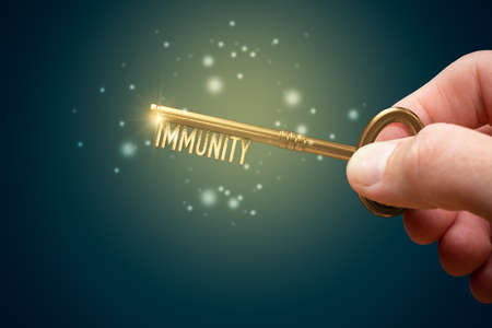 Key to boost your immune system is in your hand. Immunity improvement concept. Immunization is key to success in  epidemic.