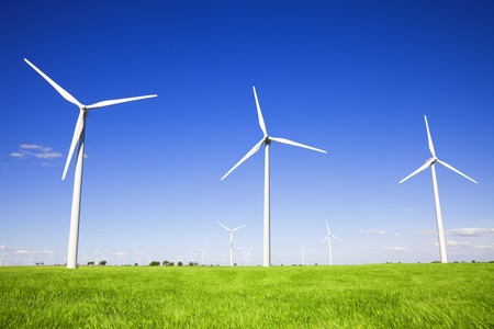 Wind turbines against blue sky photo