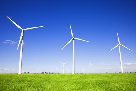 Wind turbines against blue sky photo