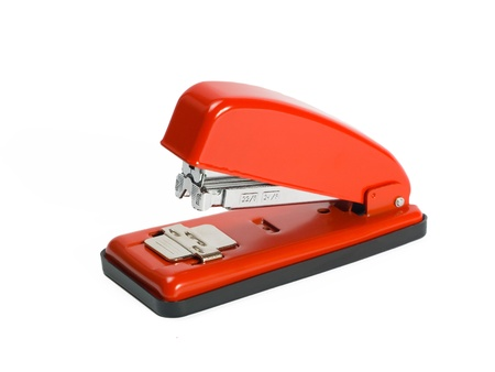 grapadora: Grapadora roja sobre fondo blanco