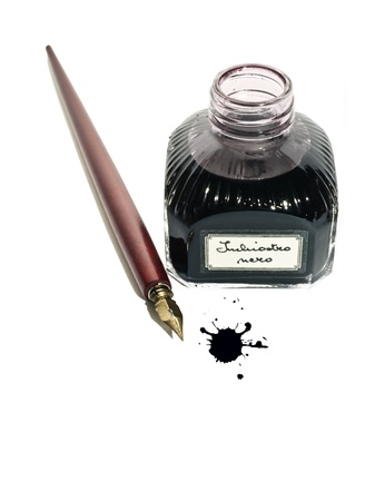 Vintage ink well and fountain pen on white background