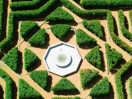 Hedges gardens with fountain, aerial view photo
