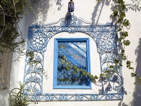 lattice window: Arabic lattice window in a Tunisian courtyard