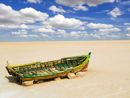 dream lake: Old boat on a dry lake in Tunisia  Stock Photo