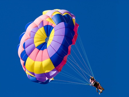 Parasailing on clear blue sky Stock Photo
