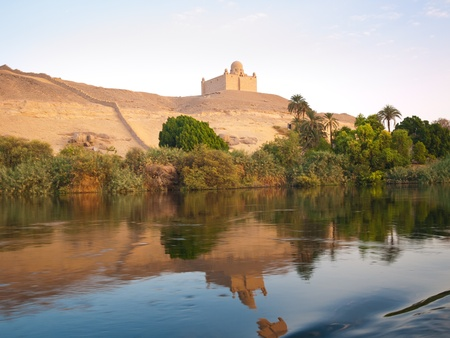 nile: The Agha Khan mausoleum and its reflect in the Nile  Egypt series Stock Photo