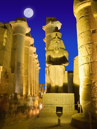 thebes: Colosus of Rameses II in Luxor temple at night  Thebes, Egypt Stock Photo